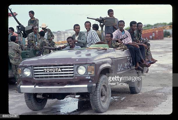Militamen part of a factional group fighting in the civil war gather in a Toyota technical car just prior to the arrival of US and international...
