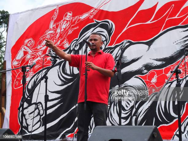 Militant activist seen speaking to the protesters during the protest Leftist groups stage Bonifacio Day of protest in Mendiola and at the US Embassy...