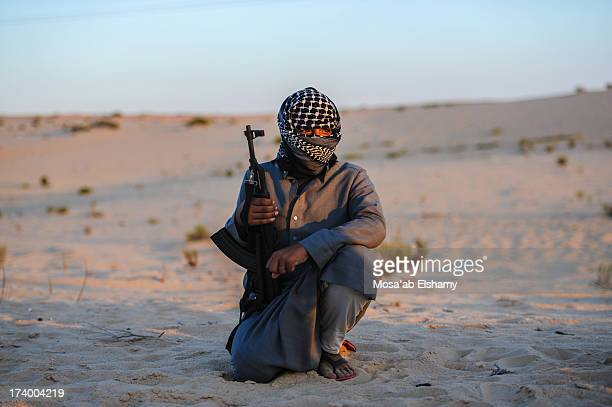CONTENT] A militant belonging to armed Bedouin groups poses for a photo The volatile peninsula has seen frequent attacks by militants on military and...