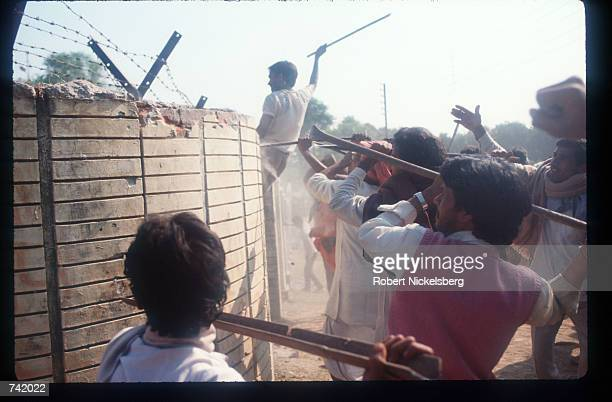 Militant Hindus storm a mosque October 29 1990 in Ayodhya India While religious parallels and differences have fueled feuding between Hindus and...