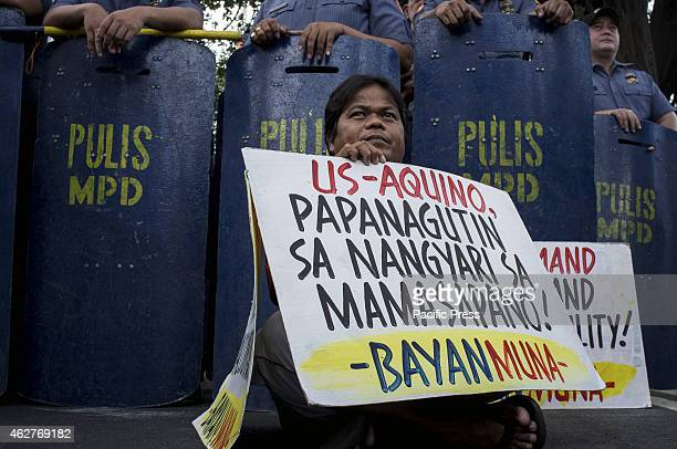 MANILA PHILIPPINES MANILA PHILIPPINES A militant hold his banner calling the Aquino regime accountable for the Mamasapano incident