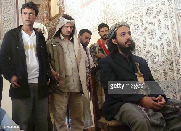 Militant leader Tareq alDahab a brotherinlaw of USborn jihadist cleric Anwar alAwlaqi who was killed in a US drone strike last September sits in the...