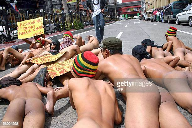 Militant university dropouts hold s nude diein protest in the 'University Belt an area that hosts many educational institutes in Manila 01 June 2005...