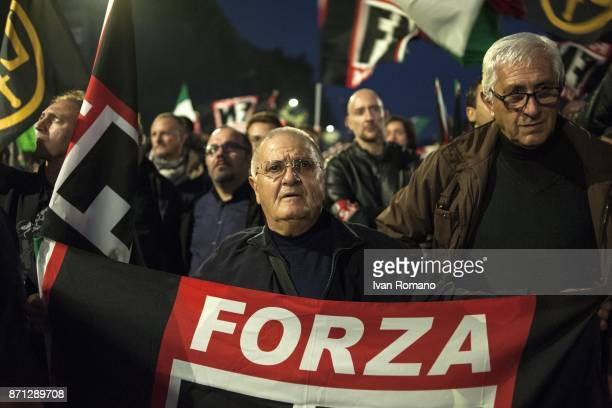 Militant with the flag of Forza Nuova in the Eur neighborhood built during the Twenty Years of Benito Mussolini's fascism in Rome for Everything for...
