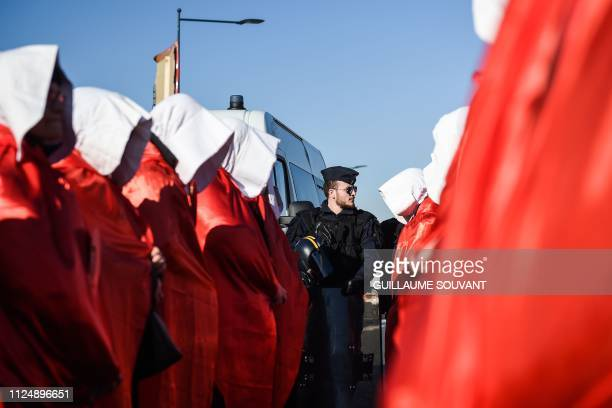 TOPSHOT Militants against the closure of Le Blanc's maternity hospital dressed as the characters of the handmaid's tale US TV show take part in a...