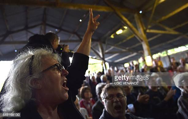 Militants against the NotreDamedesLandes airport react as they listen to the results at the Vache rit farm after a local referendum organised in...