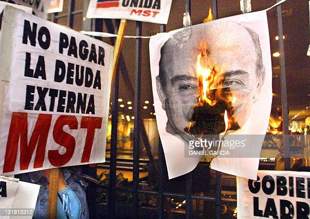 Militants burn an image of Economic Minister Domingo Cavallo 13 December 2001 in Buenos Aires Argentina during a general strike called by the Workers...