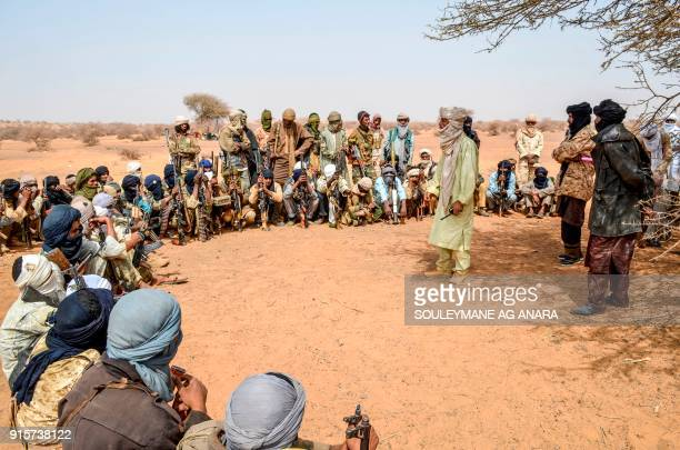 Militants of The Movement for the Salvation of Azawad listen to instructions at a waypoint while patrolling along the MaliNiger border in the...