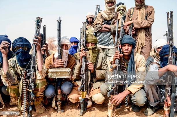 TOPSHOT Militants of The Movement for the Salvation of Azawad listen to instructions at a waypoint while patrolling along the MaliNiger border in the...