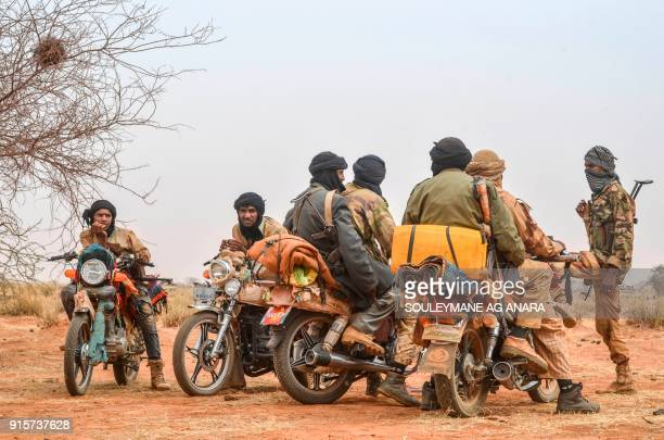 Militants of The Movement for the Salvation of Azawad stand at a waypoint while patrolling along the MaliNiger border in the deserted area in the...
