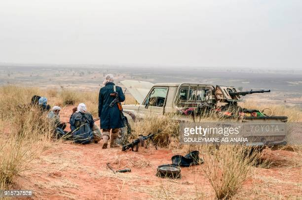 TOPSHOT Militants of The Movement for the Salvation of Azawad stand on a dune in the deserted area of the Meneka region in Mali during an anti...