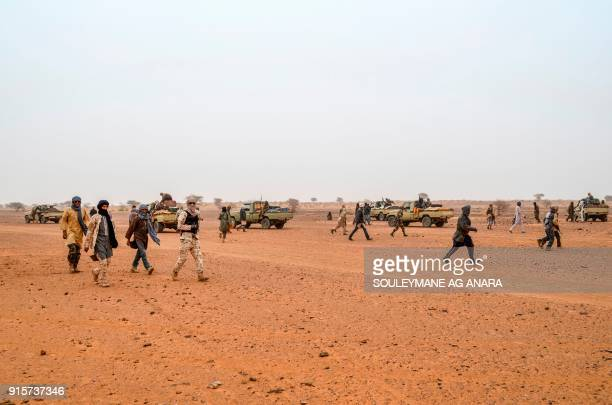 Militants of The Movement for the Salvation of Azawad walk at a waypoint while patrolling along the MaliNiger border in the deserted area in the...