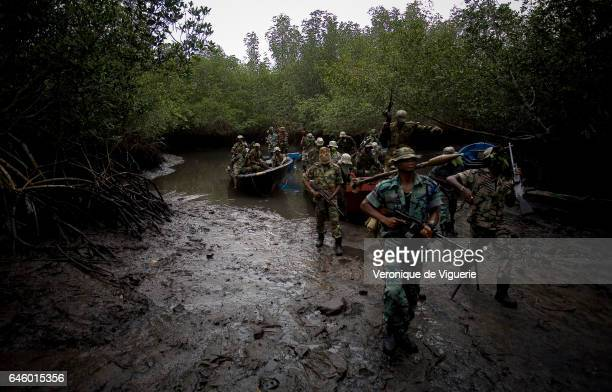 Militants working under Ateke Tom the big chief of the MEND in the mangroves near one of the eleven camps he rules in the Niger delta