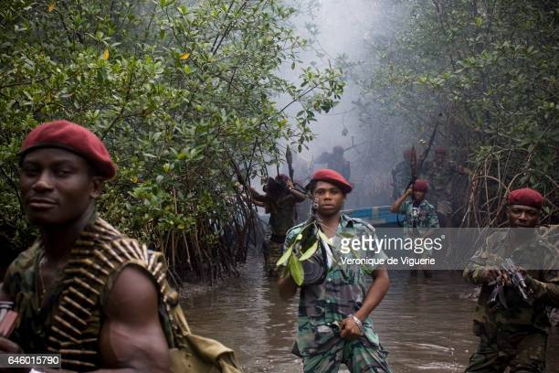 Militants working under Ateke Tom the big chief of the MEND travelling to camp nine which is just one of the eleven camps he rules in the mangroves...