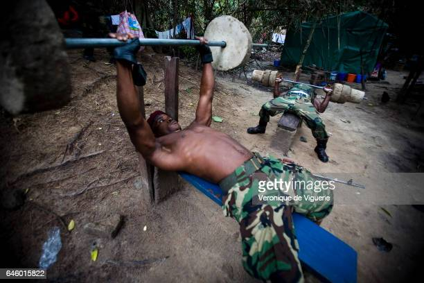 Militants working under Ateke Tom the big chief of the MEND working out in camp nine which is just one of the eleven camps he rules in the mangroves...