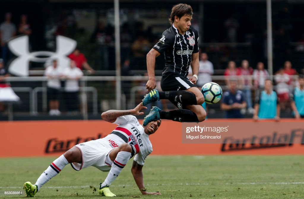 Militao (L) of Sao Paulo vies for the ball with Romero of Corinthians during the match between Sao Paulo and Corinthians for the Brasileirao Series A 2017 at Morumbi Stadium on September 24, 2017 in Sao Paulo, Brazil.