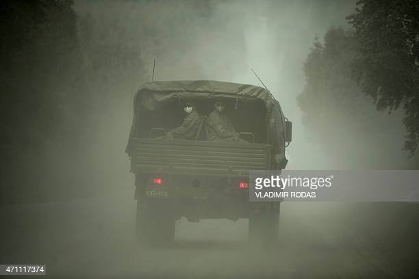 Militar truck drives on the Hueno Hueno - Puerto Varas road on April 25, 2015. Calbuco volcano kept villagers on edge as it spewed fire and ash after...