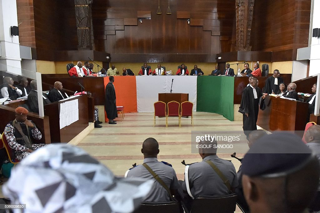 Militaries and officals attend the trial of Ivory Coast's former first lady at the appeal court of Abidjan on May 31, 2016. Simone Gbagbo goes on trial for crimes against humanity in what many see as a litmus case for justice in the West African country. The hearings into the 66-year-old's role in post-election carnage in 2010 is expected to last a month with 32 witnesses testifying. / AFP / ISSOUF