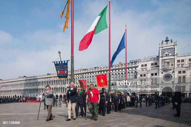 People with Venetian flags attend the celebrations of the Patron San Marco in St Mark square on April 25 2018 in Venice Italy Today in Venice its the...