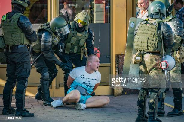 Militarized police arrests a man in the streets of Minsk, Belarus, on August 11, 2020. There is a high presence of police, patrolling the city and...