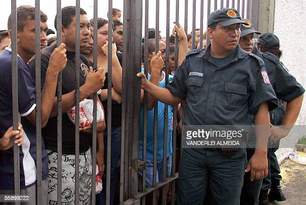 Militarized police officers block the gates of Mangueirao stadium to soccer fans gathered to attend Brazil's team training session 11 October 2005 at...