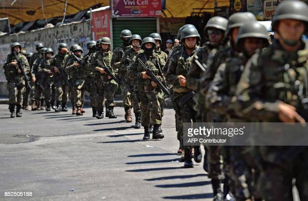 PM militarized police personnel in combat gear deploy at Rocinha favela in Rio de Janeiro Brazil on September 23 2017 Although shooting was reported...