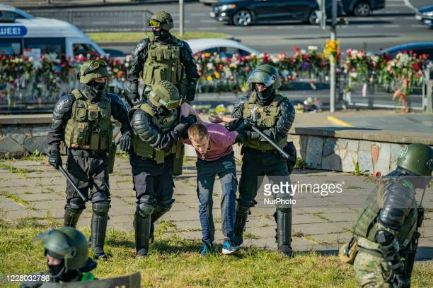 Militarized policemen arrest a man in Minsk, Belarus, on August 11, 2020. There is a high presence of police, patrolling the city and arresting...