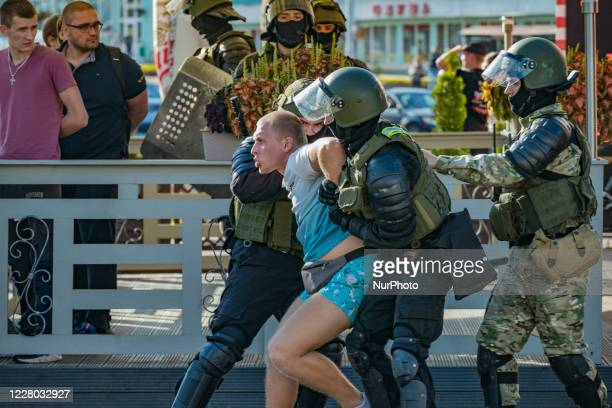 Militarized policemen fight with an arrested man in the streets of Minsk, Belarus, on August 11, 2020. There is a high presence of police, patrolling...