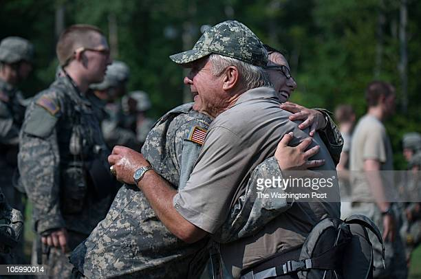 Military Academy alum Joel Sugdinis hugs Kathryn Knapp during a break from a 12mile 'March Back' as the Plebes return to the Academy from their...