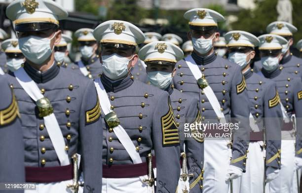 Military Academy cadets attend the 2020 graduation ceremony at West Point, New York, on June 13, 2020. - US President Donald Trump is delivering the...