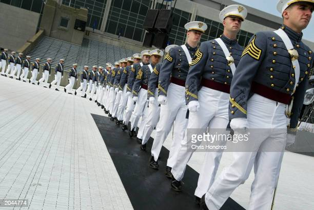 Military Academy cadets march into Michie Stadium for commencement exercises May 31, 2003 in West Point, New York. Over 800 cadets graduated and...