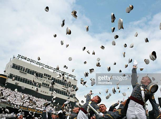 S Military Academy cadets toss their hats into the air at the conclusion of the 2006 commencement activities at Michie Stadium Saturday May 27 in...