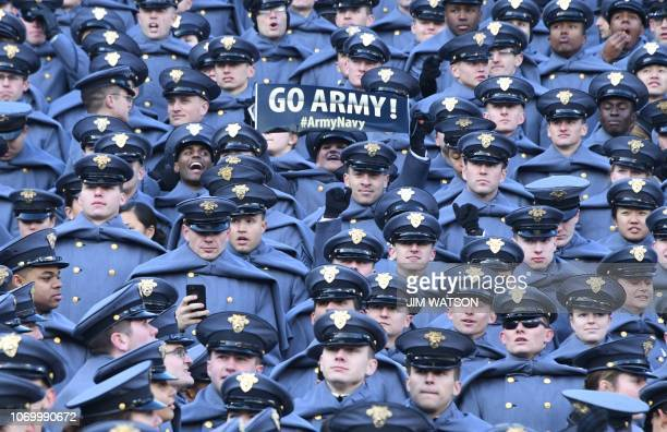 Military Academy show their support prior to the annual ArmyNavy football game at Lincoln Financial Field in Philadelphia Pennsylvania December 8...