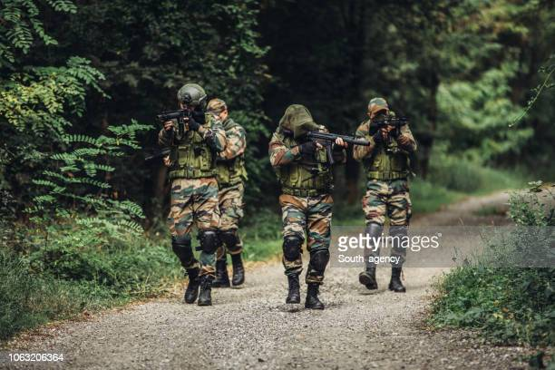 military action - military training stock pictures, royalty-free photos & images