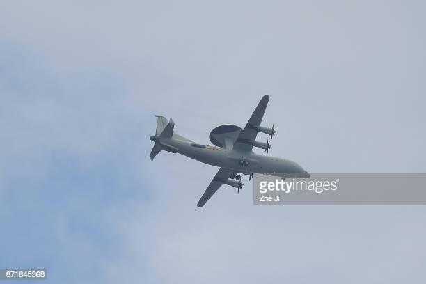 A military Air Early Warning does a flyover on the 18th hole during the Blue Bay LPGA at Jian Lake Blue Bay golf course on November 8 2017 in Hainan...