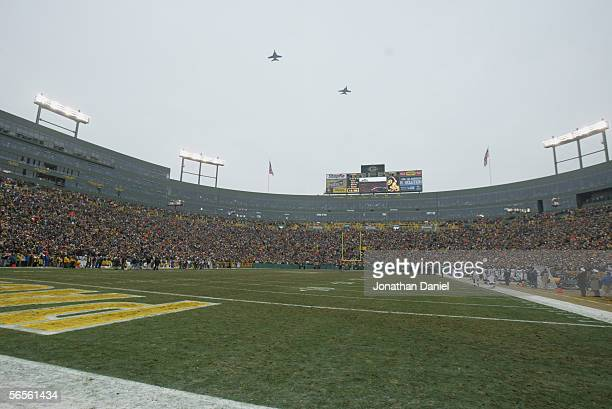 Military aircraft fly over Lambeau Field prior to the game between the Green Bay Packers and the Seattle Seahawks on January 1, 2006 at in Green Bay,...