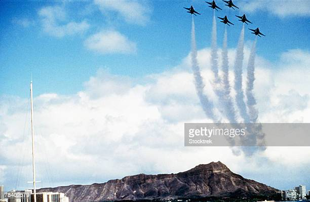 Military aircraft flying in formation