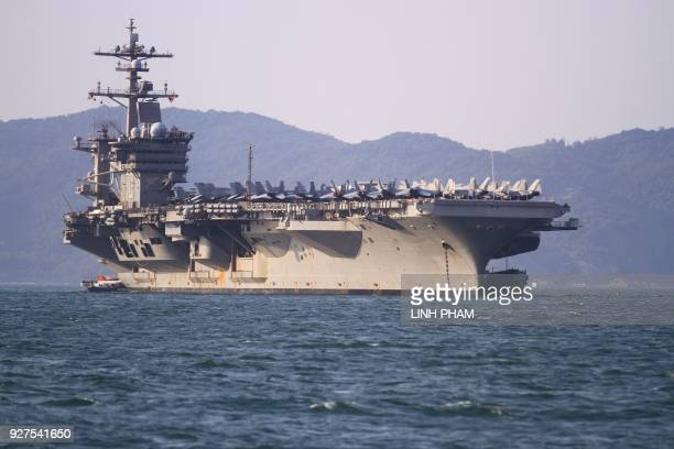 Military aircraft including F/A18 fighter jets are seen parked on the flight deck of the USS Carl Vinson the US Navy's nuclearpowered Nimitzclass...