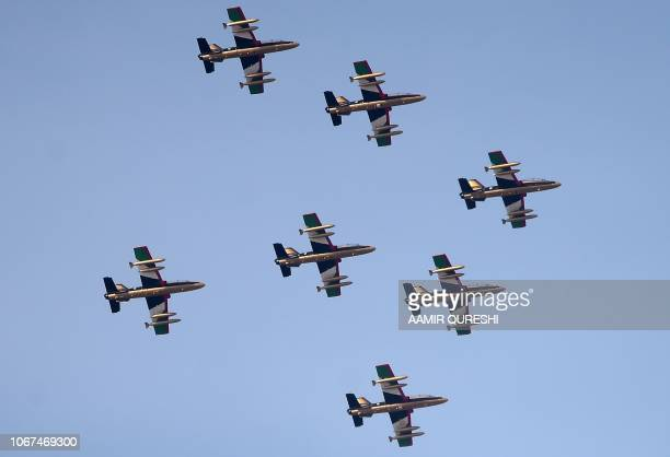 Military aircraft of the United Arab Emirates fly past the Sheikh Zayed International Cricket Stadium in Abu Dhabi on December 2 2018 The United Arab...