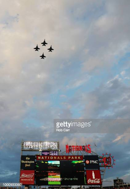 Military aircraft perform a flyover before the 89th MLB AllStar Game presented by Mastercard at Nationals Park on July 17 2018 in Washington DC