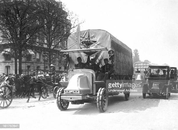 A military airplane being transported by truck for the French National Festival on July 14 Paris France July 14 1914