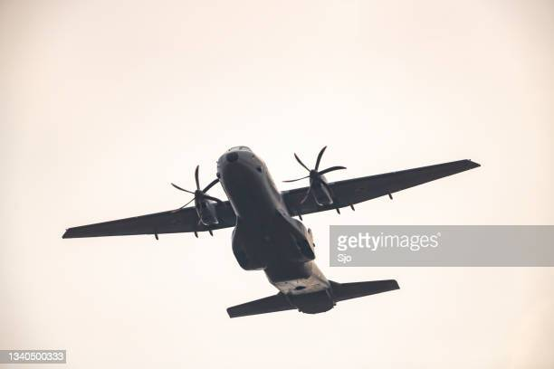 """military airplane casa c-295 flying in mid air - """"sjoerd van der wal"""" or """"sjo"""" stock pictures, royalty-free photos & images"""
