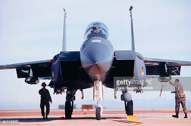 military airplane on runway - air force stock pictures, royalty-free photos & images