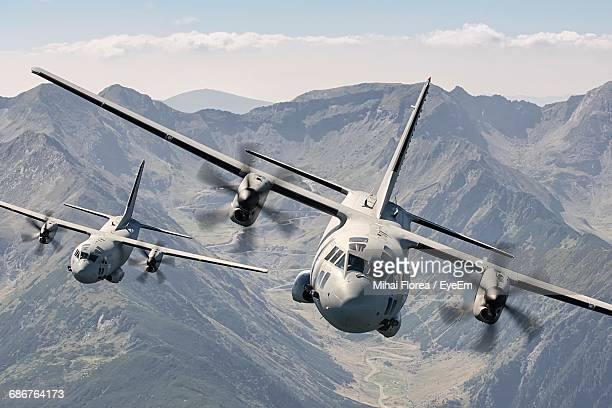 Military Airplanes Flying Over Mountains