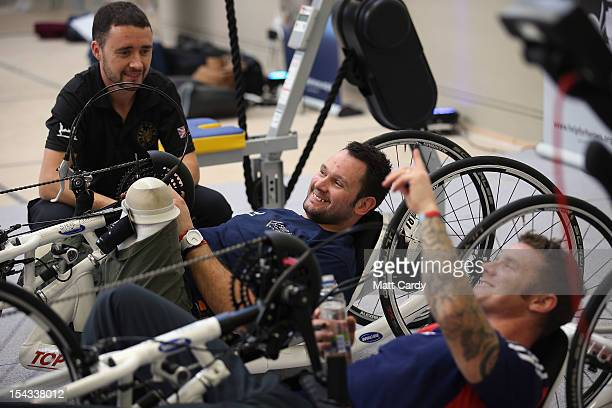 Military amputee Steve Arnold laughs as he uses a hand bike in the new Help for Heroes' Tedworth House rehabilitation centre for wounded servicemen...