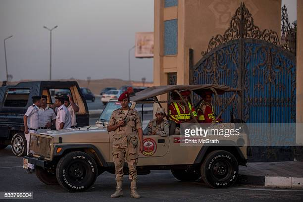 Military and members of the Egyptian police force stand guard outside the ElMosheer Tantawy Mosque ahead of the memorial ceremony held by EgyptAir...