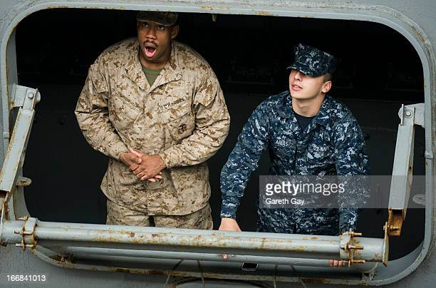 Military and Navy personnel Look out over the harber aboard the USS Peleliu during it mooring at Tsim Sha Tsui on April 16 2013 in Hong Kong The...