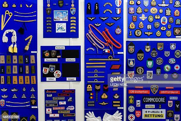 Military and police uniform badges and decorations are displayed on the Albrecht Bender stand inside the ExCeL centre in London on September 15...