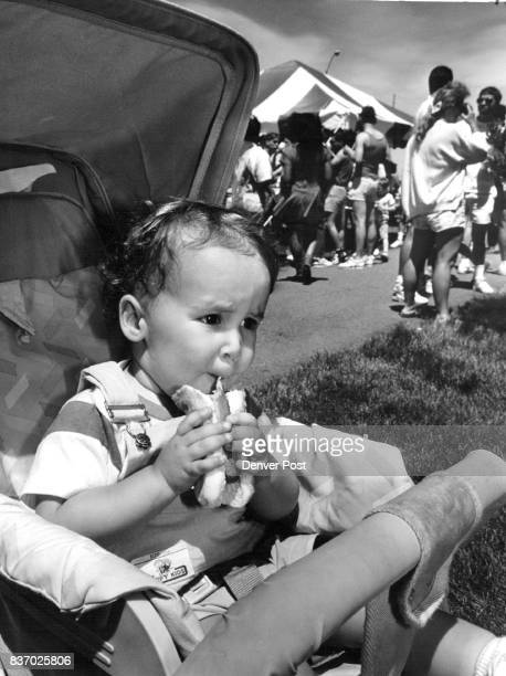 Military appreciation Day Kirk Daley 22 months old eats hotdog His farther is Sgt Paul F Daly who is stationed at Lowry Credit The Denver Post