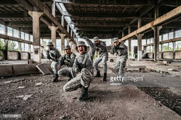 military assault team charging in battle - military attack stock pictures, royalty-free photos & images